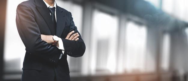 asian-businessman-blurred-office-copyspace_1379-3835